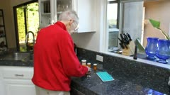 Elderly Man putting pills away Stock Footage