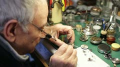 Watchmaker disassembles a wristwatch for repair Stock Footage