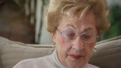 CU Elderly woman reading Stock Footage