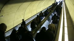 Commuters go up on escalator at a subway metro station Stock Footage