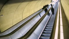 Commuters go up on escalator at a subway metro station time lapse - stock footage