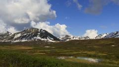 Tilt Down from Cloudy Sky to Hatcher Pass Mountains and Mine Alaskan Scenic Stock Footage