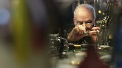 Watchmaker examines old  watch Stock Footage