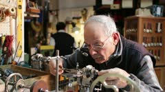 Watchmaker working with a antique lathe Stock Footage
