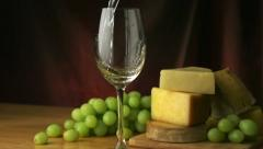 Pouring white wine into glass, Slow Motion Stock Footage