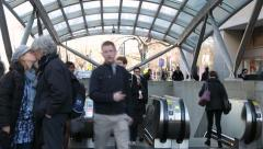 Commuters coming up escalator and out to the street time lapse Stock Footage
