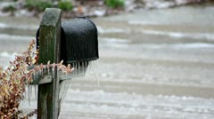 Freezing Rain forming icicles on mailbox - water running on street. Stock Footage