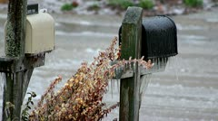 Freezing Rain forming icicles on 2 mailboxes during winter storm. Stock Footage
