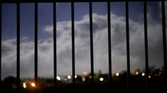 Time Lapse of Clouds moving past a Gate Stock Footage