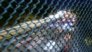 Time Lapse of Night Traffic behind Wire Fence Stock Footage