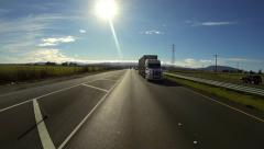 Driving Rearview POV - Cattle Truck Passing on Highway 37 Stock Footage