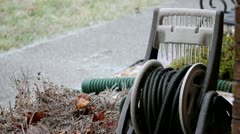 Freezing Rain raining on hose in yard - stock footage