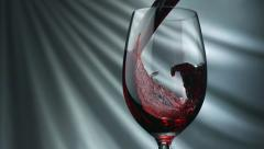 Pouring red wine into glass, Slow Motion Stock Footage