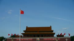 Chinese red flag flutters in wind.China Beijing Tiananmen Square plaza. Stock Footage