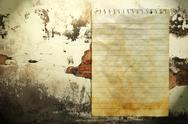 Old notebook paper on wall background Stock Photos