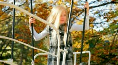 Child on swing boat in park Stock Footage