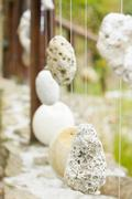 wooden railing with hanged stones - stock photo