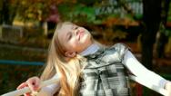 Little blonde girl on swing boat Stock Footage