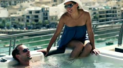 Rich people having fun in jacuzzi, slow motion shot at 120fps Stock Footage