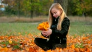 Stock Video Footage of Child playing in the autumn leaves