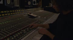 Recording Engineer Working at Mixing Console - handheld Stock Footage