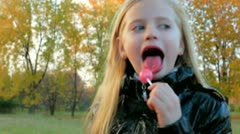 Child eating candy Stock Footage