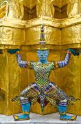 guardians surrounding temple, golden pagoda at wat phra kaew - stock photo
