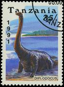 tanzania - circa 1991: a stamp printed in tanzania shows diplodocus, circa 19 - stock photo