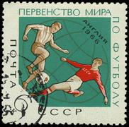 ussr - circa 1966: a stamp printed in ussr showing football players, circa 19 - stock photo