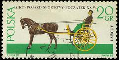 Poland - circa 1965: a stamp printed in poland showing horses drawing carriag Stock Photos