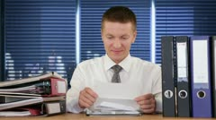 Young Businessman getting fired through a letter - stock footage