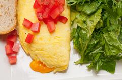 cheese ometette with tomato and salad - stock photo