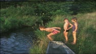 Stock Video Footage of Vintage 8mm film: Children jumping in pond, 1960s