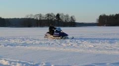 Man helmet goggle drive snowmobile transport frozen lake winter Stock Footage