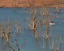 Lake Hume Australia, Hume weir, dam with a fishing boat Stock Footage