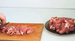 Cutting meat Stock Footage