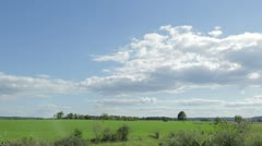Fluffy White Clouds in Blue Sky Over Country Field Stock Footage