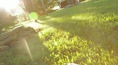 Barefoot Woman Walking in Grass Stock Footage