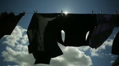 Clothes Blowing on Clothesline - stock footage