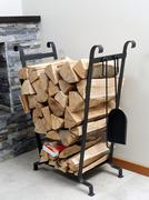 firewood on metal stand - stock photo