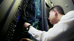 Stock Video Footage of IT engineer working on server wiring in a data centre