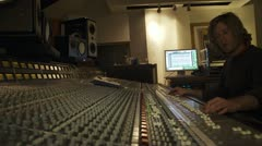 Recording Engineer at Mixing Board in Studio Stock Footage