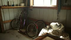 Bicycles and Wooden Wagon in Shed Stock Footage