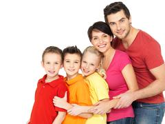 Happy family with children standing together in line Stock Photos