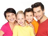 Stock Photo of happy family with two children on white