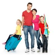 Happy family with  suitcase  at studio Stock Photos