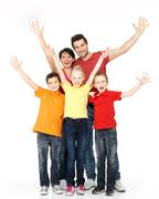 Happy family with raised hands up Stock Photos