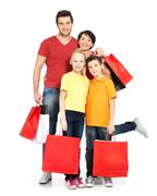 Family with shopping bags standing at studio Stock Photos