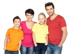 happy family with two children on white - stock photo