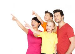 Family with two children pointing finger up Stock Photos